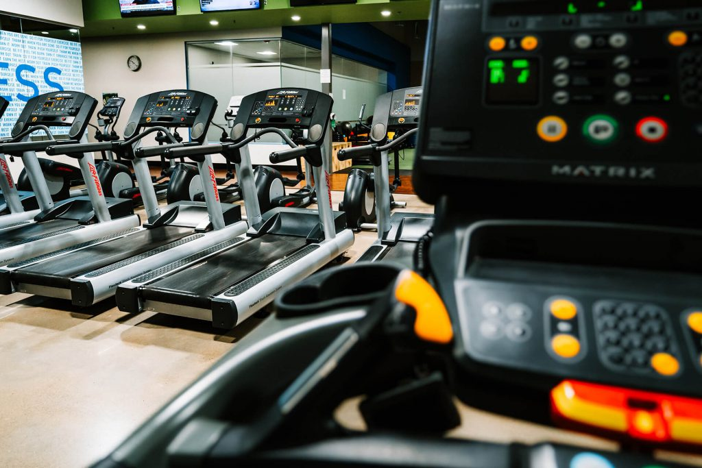Treadmills with no one on them.